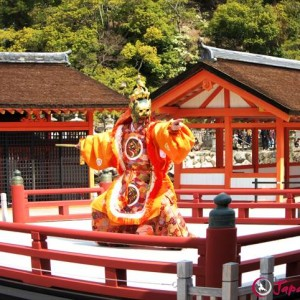 Noh dance on a wedding day on the stage of Itsukushima shrine